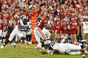 OU ryunning back Damien Williams runs the ball Saturday night against TCU.  The Sooners won the game, 20-17