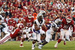 TCU quarterback Trevone Boykin tries to escape OU's Eric Striker Saturday night