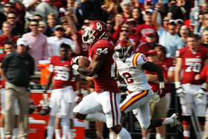 Sooner running back Brennan Clay breaks free on a 63-yard touchdown run Saturday against Iowa State