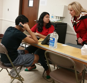 Gov. Mary Fallin talks to a caseworker and a minor being held at a temporary shelter at Fort Sill. PROVIDED PHOTO