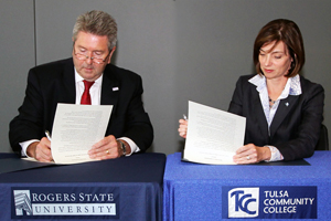RSU President Larry Rice and TCC President & CEO Leigh B. Goodson sign articulation agreements September 3, 2014