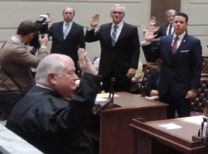 The Honorable John Reif, Chief Justice-Elect of the Supreme Court, administers the oath of office to newly elected and reelected members of the Senate.