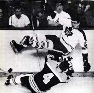 Pat Quinn nearly taking Bobby Orr's head off