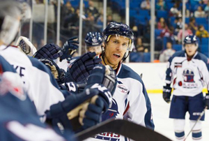 Drew Fisher fist-bumps his teammates after his goal - Photo by Kevin Pyle