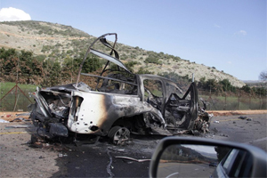 A burnt vehicle is seen near the village of Ghajar on Israel's border with Lebanon. (Photo:REUTERS/JP)
