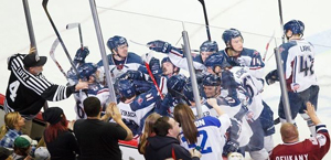 The Oilers celebrate the game winner in overtime on Friday night. Photo Kevin Pyle