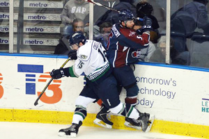 Dave Pszenyczny collides with Jeff Costello in Everblades game. Photo courtesy Florida Everblades.