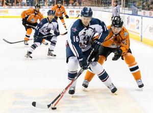 Oilers defenseman Jake Obermeyer (16) battles Sebastien Thinel (43) in action Friday night.