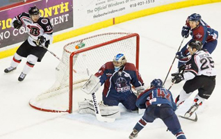 The Rush's Daniel Barczuk (25) scores the game winner against the Oilers Thursday night. Photo: Kevin Pyle