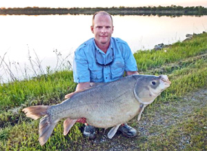 Allen Bynum of Ardmore with his state-record bighead buffalo weighing 60 pounds 6 ounces