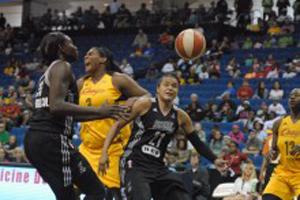 Courtney Paris rejects a San Antonio shot.