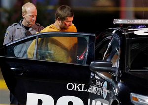 Christian Costello is taken into custody Sunday night. Photo Courtesy, The Oklahoman