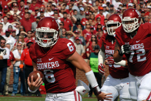OU quarterback Baker Mayfield breaks free in the open field.