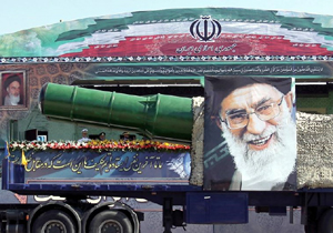 A MILITARY truck carrying a missile and a picture of Iran's leader Ayatollah Ali Khamenei drives in a parade marking the anniversary of the Iran-Iraq war in Tehran. (photo credit: REUTERS viva The Jerusalem Post)