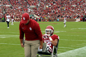 OU cornerback Zack Sanchez is wheeled off the field after suffering an ankle injury on the first play against Texas Tech Saturday in Norman.