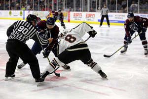 Brandon Wong of the Oilers settles in for the face off with Quad City's Matthew Neal.