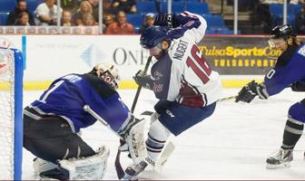 Bryan Nugent skates in on Thunder goalie David Shantz.
