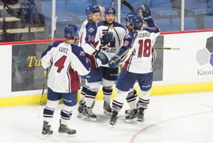 The Oilers celebrate Brandon Wong's (center) goal in the first period on Sunday. Photo: Kevin Pyle