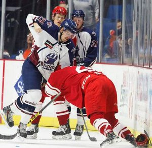 Matthieu Gagnon hooks up with Ayrton Nikkel in an altercation in the second period on Tuesday night.
