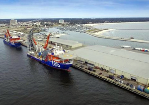 Lay Vessel 105 and North Ocean 102 are docked to support operations at McDermott's spoolbase facility in Gulfport, Mississippi.