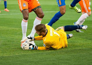 Alex Mangels makes one of his 12 saves in a 2-0 Roughnecks win on Saturday. Photo: Rich Crimi