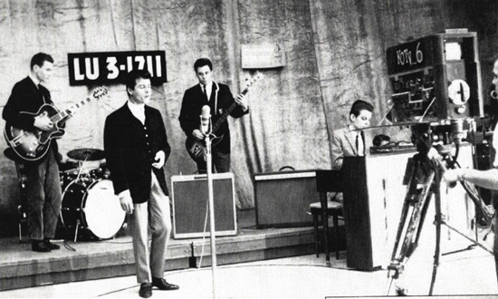 "This KOTV photo is from the 1958 March of Dimes Telethon, Left to right, Tommy Crook, drummer Chuck Blackwell, Jimmy 'Junior' Markham, Bill Raffensperger and (Leon) Russell Bridges (""It was like 2 AM after our nightclub gig."" - Jr)"
