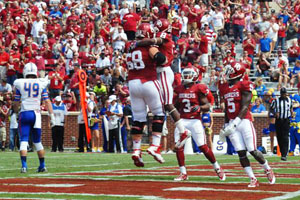 Jalen Saunders celebrates his touchdown with Broonson Irwin as Sterling Shepard and Durron Neal look on