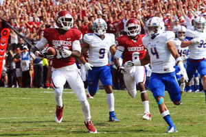 OU's Jaz Reynolds (16) looks for running room as TU's Darnell Walker, Jr. (4) and Dwight Dobbins (9) give chase.  Also pictured:  Jalen Saunders (8)