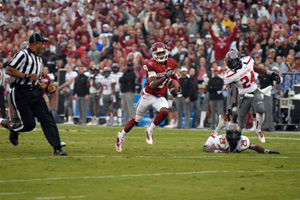 Jalen Saunders runs for the end zone to complete a 76-yard scoring strike from Blake Bell