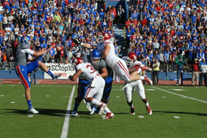 Trevor Pardula's punt is bloocked by OU's Matt Dimon, resulting in a safety