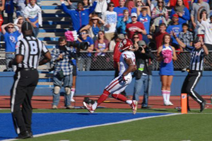 Sooner receiver Sterling Shepard crosses the goal line after catching a pass from Lacoltan Bester.  The Sooners beat Kansas 34-19 Saturday