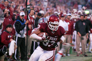 OU's Trey Millard carries the ball Saturday against Texas Tech.  Millard was lost for the season with a knee injury