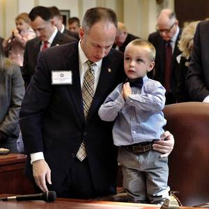 Jeff Hickman stands with his son, Austin Hickman, 3, during an invocation NewsOK.com