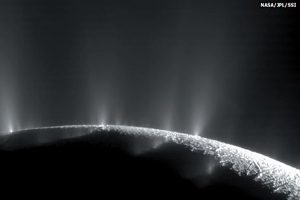 Enceladus shown here as jets of water shoot into space.  (NASA)