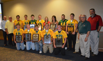 Scholarship recipients are pictured with corporate sponsors during the annual awards banquet for 8-man football week in Miami, Oklahoma.  $11,000 in total awards are given out each year.
