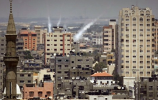 Smoke from rockets fired from Gaza City launched toward Israel,  July 15, 2014 ( photo: AFP/ Thomas Coex/)