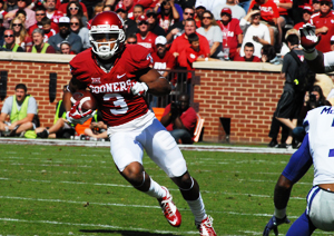 Sooner wide receiver Sterling Shepard looks for daylight against Kansas State.  Coach Bob Stoops said fans shouldn't expect to see Shepard play against OSU.