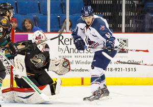 Oilers Charles LeChance battles for points - Photo Kevin Pyle