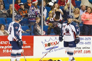 """""""Luke Judson (left) and T.J. Caig watch the tossing of teddy bears after Tulsa's first goal Friday night"""" - Photo by Kevin Pyle"""
