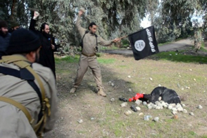 ISIS stones a woman to death for allegedly committing adultery.