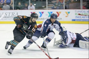 Oilers captain Nathan Lutz battles Mallards forward Jeff Lee on Wednesday night.