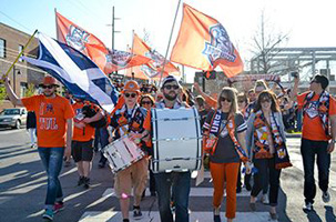 The Roughnecks supporters known as the Roustabouts march to ONEOK Field from a rally on Guthrie Green. Photo: Jordan Suskind