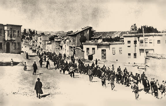 Armenian Christians in a forced march under guard in 1915.