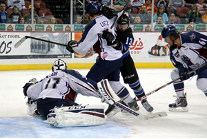 Kevin Carr (seated) stretches to make a save in front of his net on Friday night in Wichita.