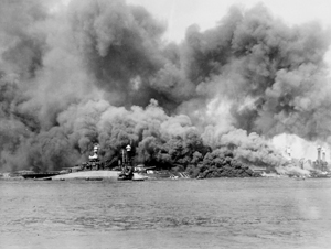 USS Oklahoma capsizes in a photo taken during the attack on Pearl Harbor. Wikipedia.org