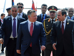 """Egyptian President Abdel Fattah al-Sisi, right, greets Jordan's King Abdullah II on his arrival to attend an Arab summit, in Sharm el-Sheikh, South Sinai, Egypt, Saturday, March 28, 2015. In a speech to Arab leaders, Yemen's embattled president on Saturday called Shiite rebels who forced him to flee the country """"puppets of Iran,"""" directly blaming the Islamic Republic for the chaos there and demanding airstrikes against rebel positions continue until they surrender. (AP Photo/MENA/Washington Times)"""