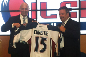 Oilers GM Taylor Hall presents Jason Christie with a jersey after his introduction as the Oilers head coach.