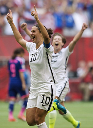 United States' Carli Lloyd (10) and Meghan Klingenberg (22) celebrate Lloyd's third goal against Japan during first half action in the FIFA Women's World Cup soccer championship in Vancouver, British Columbia, Canada, Sunday, July 5, 2015. (Jonathan Hayward/The Canadian Press via AP/Washington Times) MANDATORY CREDIT