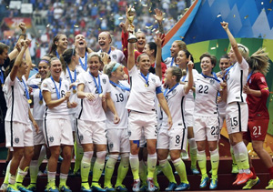 The United States Women's National Team celebrates with the trophy after they beat Japan 5-2 in the FIFA Women's World Cup soccer championship in Vancouver, British Columbia, Canada, Sunday, July 5, 2015. (AP Photo/Elaine Thompson/Washington Times)