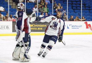 Oilers Captain Nathan Lutz congratulates goalie Kevin Carr. Lutz scored the game winning goal and Carr made 17 saves.